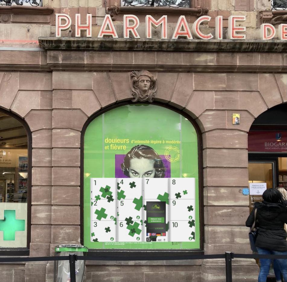 Maintenance automate installé dans la vitrine d'une pharmacie